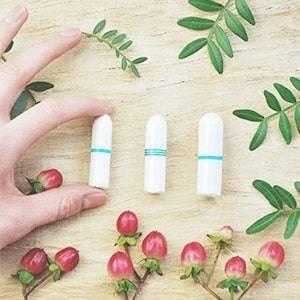 Bio-Tampon mit Hand
